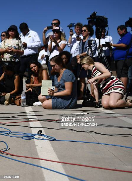 Activists join mayors of US cities to protest at the Tornillo Port of Entry near El Paso, Texas, June 21, 2018 against the US administration's family...