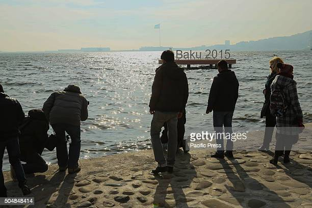 Activists leave red cloves at the Caspian seaside to mark the 40th day of the death of oilmen from the date of the accident at the offshore field...