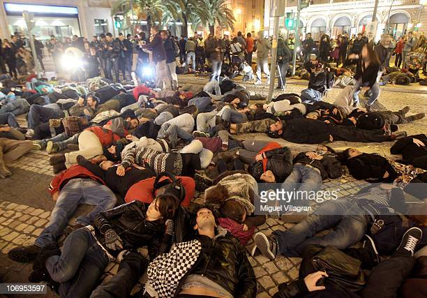 Activists lie on the pavement in front of the Estacao do Rossio train station during a flashmob performance as sign of protest against the NATO...