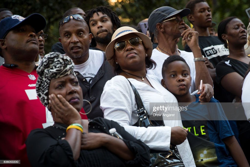 Activists listen to a speaking program during a rally in support of NFL quarterback Colin Kaepernick outside the offices of the National Football League on Park Avenue, August 23, 2017 in New York City. During the NFL season last year, Kaepernick caused controversy by kneeling during the National Anthem at games to protest racial oppression and police brutality. Kaepernick is currently a free agent and some critics and analysts claim NFL teams don't want to sign him due to his public display of his political beliefs.