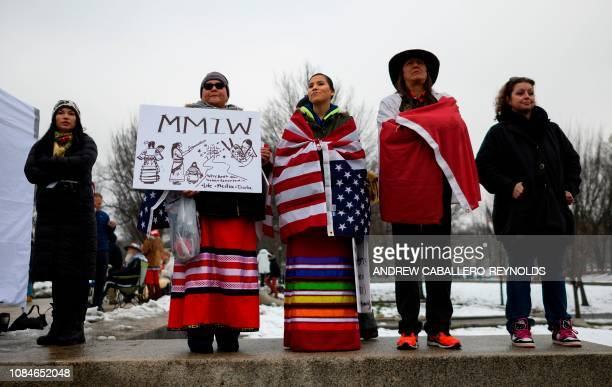 Activists listen to speakers during the Indigenous People's March on the National Mall at the Lincoln Memorial in Washington DC on January 18 2019