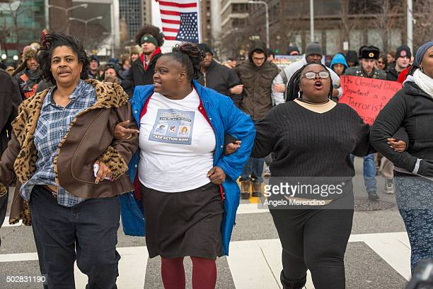 Activists lock arms and march down E 9th St on December 29 2015 in Cleveland Ohio Protestors took to the street the day after a grand jury declined...