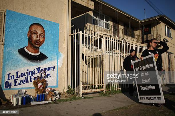 Activists look at a mural of Ezell Ford a 25yearold mentally ill black man at the site where he was shot and killed by two LAPD officers in August on...