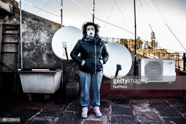 Activists Lucia Lo Martire portrait realized on the top of a house in the Tamburi District Taranto Italy On November 27 and 28 schools closed in the...