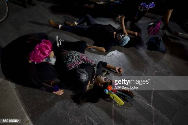 Activists madeup as Catrina perform in a demonstration against feminicide on the eve of the Day od the Dead celebrations in Mexico City November 1...