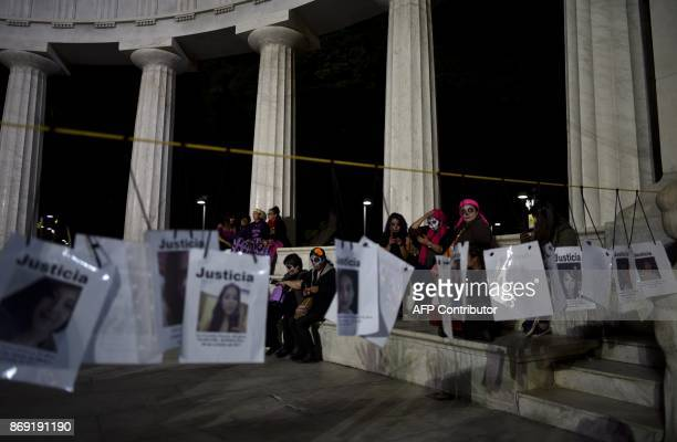 Activists madeup as Catrina take part in a demonstration against feminicide on the eve of the Day od the Dead celebrations in Mexico City November 1...