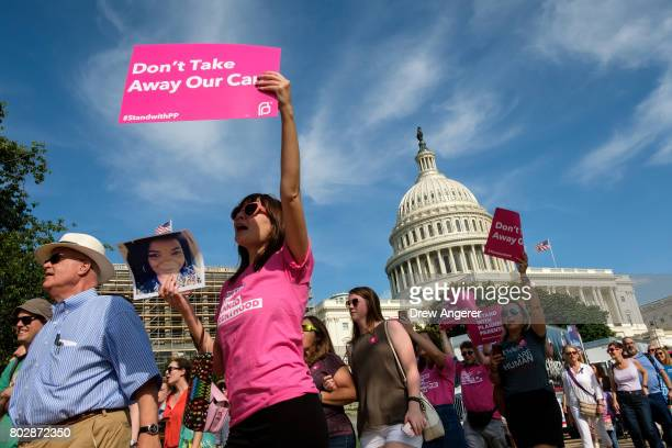 Activists march around the US Capitol to protest the Senate GOP health care bill on Capitol Hill June 28 2017 in Washington DC The protest was...