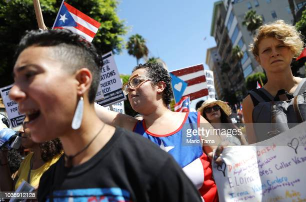 Activists march calling for support of Puerto Rico one year after Hurricane Maria devastated the island on September 23 2018 in Los Angeles...