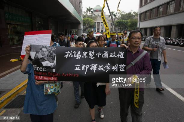 Activists march during the Commemorating Lee Ming-Ches One Year Of Imprisonment Protest in Taipei on March 19, 2018. Taiwanese human rights activist...