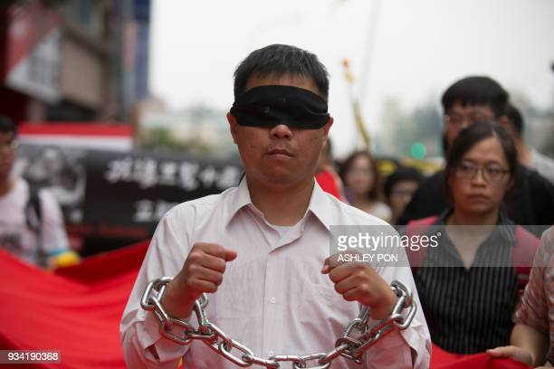 Activists march during the Commemorating Lee MingChes One Year Of Imprisonment Protest in Taipei on March 19 2018 Taiwanese human rights activist Lee...