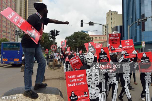 Activists march on June 5 2018 in Nairobi carrying placards bearing messages to denounce plans by the Kenyan government to mine coal close to the...