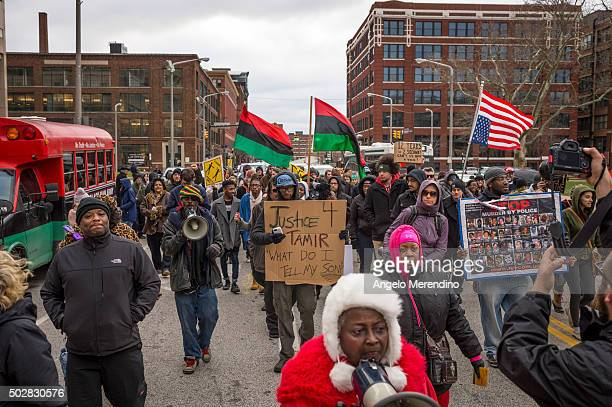 Activists march on Ontario Street on December 29 2015 in Cleveland Ohio Protestors took to the street the day after a grand jury declined to indict...