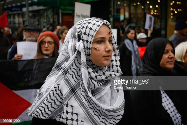 Activists march to commemorate the 70th anniversary of Nakba Day on May 19, 2018 in Melbourne, Australia.