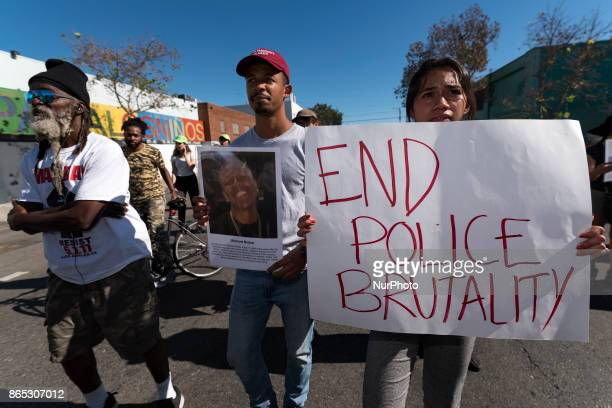 Activists march to protest police brutality in Los Angeles California on October 22 2017 The protesters marked the 22nd annual National Day of...