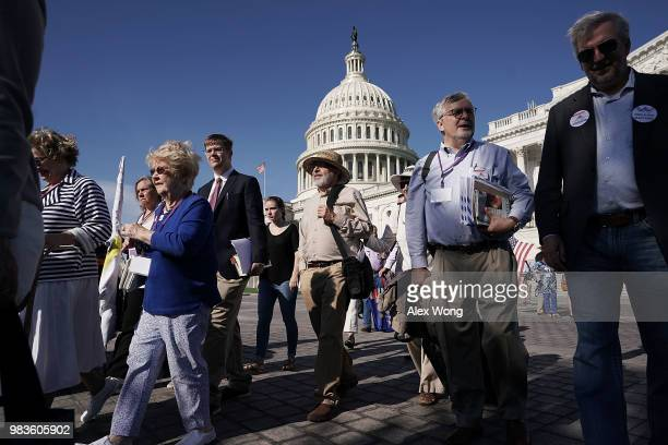Activists march to Senate Hart Office Building June 25 2018 on Capitol Hill in Washington DC Common Cause American Promise Take Back Our Republic and...