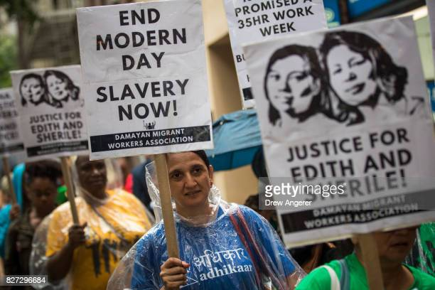 Activists march toward the German consulate during a rally to support two Filipina domestic workers in their lawsuit against a German diplomat August...