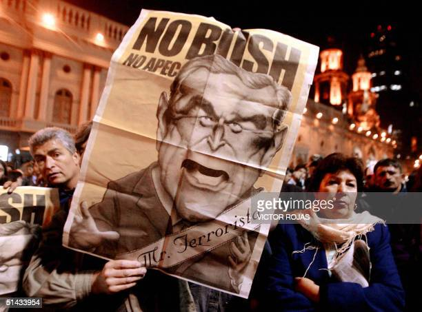 Activists march with a placard depicting US President George WBush during an anti AsiaPacific Economic Cooperation protest 06 October 2004 in...