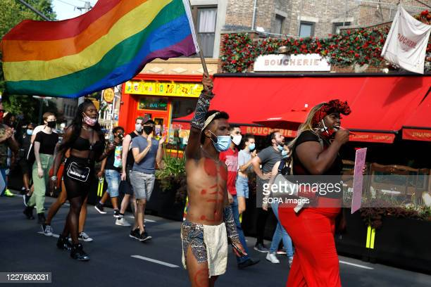 Activists march with a rainbow flag in the West Village of Manhattan. Black history and Black Trans History milestones are celebrated at the historic...