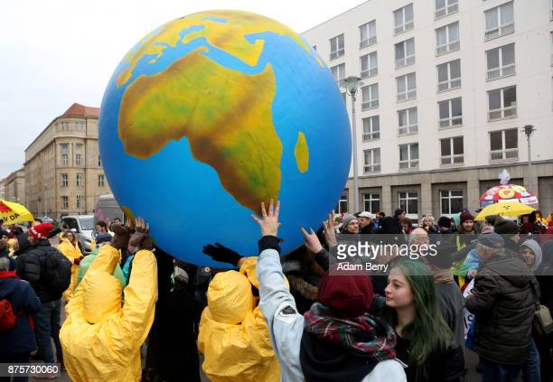 Activists march with an inflatable globe during a demonstration against nuclear weapons on November 18 2017 in Berlin Germany About 700 demonstrators...