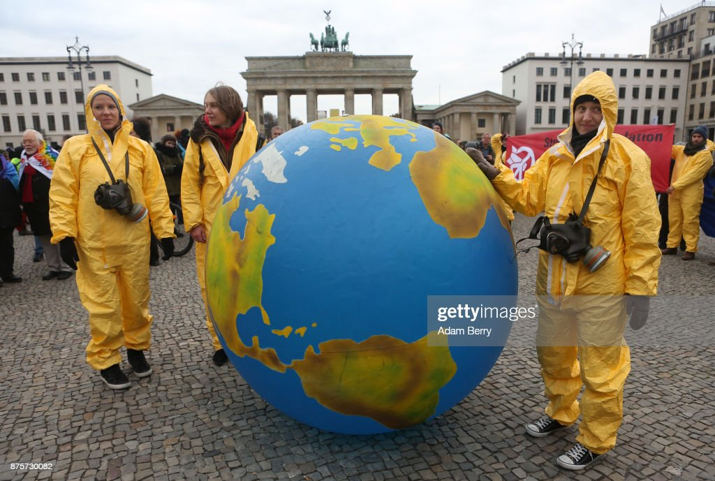 Activists march with an inflatable globe during a demonstration against nuclear weapons on November 18, 2017 in Berlin, Germany. About 700 demonstrators protested against the current escalation of threat of nuclear attack between the United States of America and North Korea. The event was organized by peace advocacy organizations including the International Campaign to Abolish Nuclear Weapons (ICAN), which won the Nobel Prize for Peace this year.