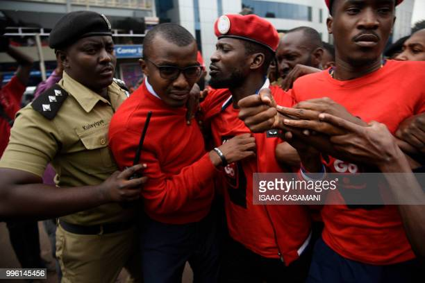 Activists musician turned politician Robert Kyagulanyi journalist Raymond Mujuni and musician Apass are arrested by police before they were whisked...