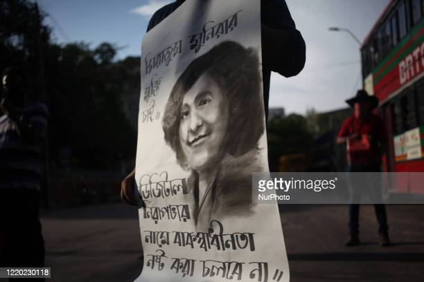 Activists of a social organisation hold placards as they demand repeal of Digital Security Act and release those who arrested under the act including...