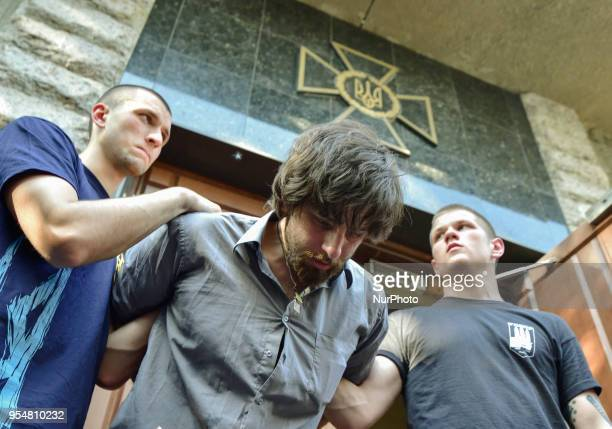 Activists of a Ukrainian farright movements hold a 33yearold Brazilian Rafael Lusvarghi a former volunteer fighter and poster boy for Russiabacked...
