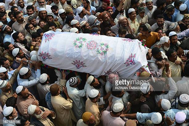 Activists of Ahle Sunnat Wal Jamaat carry the coffin of a member of the religious organisation who was shot dead by unknown assailants during the...