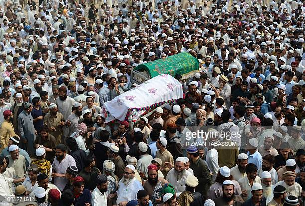 Activists of Ahle Sunnat Wal Jamaat carry the coffins of members of the religious organisation who were shot dead by unknown assailants during the...