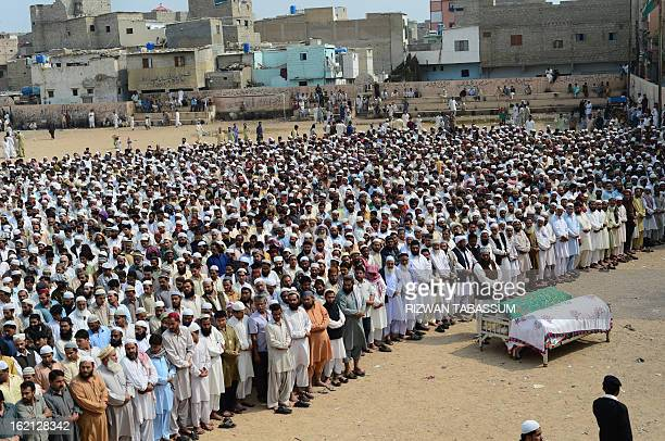 Activists of Ahle Sunnat Wal Jamaat offer funeral prayers for members of the religious organisation who were shot dead by unknown assailants during...