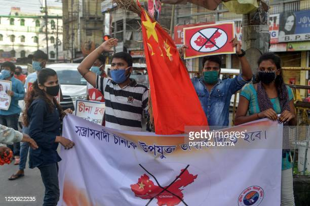 Activists of Akhil Bharatiya Vidyarthi Parishad shout slogans as they hold posters and Chinese flag during an antiChina protest in Siliguri on June...