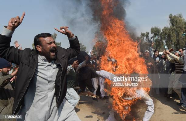 Activists of AlBadr Mujahideen burn an effigy of Indian Prime Minister Narendra Modi during an antiIndia protest in Peshawar on February 28 2019...