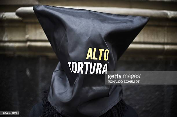 Activists of Amnesty International demonstrate against torture in Mexico before submitting to the press a report entitled 'Out of control Torture and...