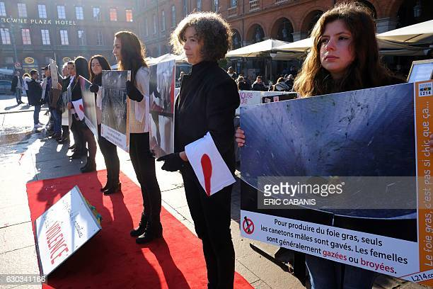 Activists of animal rights association L214 hold banners reading 'To produce Foie Gras only the male duckling are forcefeed Females are usually gased...