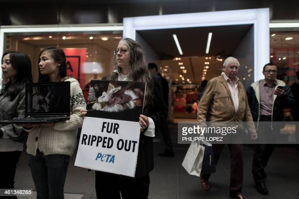 Activists of animal rights group PETA stage a protest against the sale of angora items outside a GAP outlet in Hong Kong on January 8 2014 GAP has...