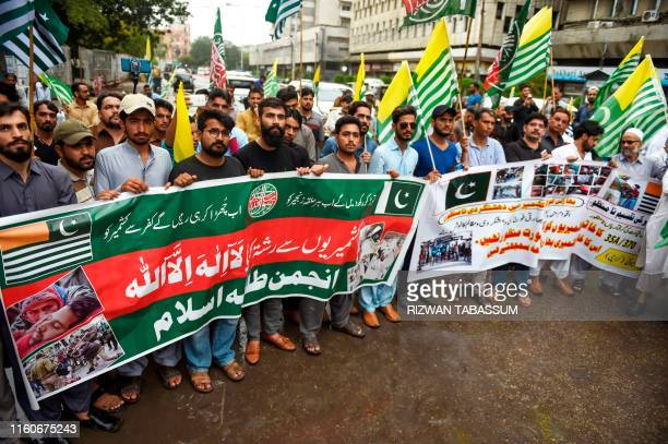 Activists of Anjuman TulabaeIslam shout slogans during an antiIndian protest rally in Karachi 10 after the Indian government stripped the disputed...
