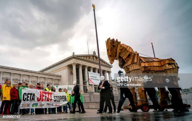 Activists of Attac Global2000 OeVB Proge Suedwind and Greenpeace participate in a protest against CETA between EU and Canada in front of the empty...