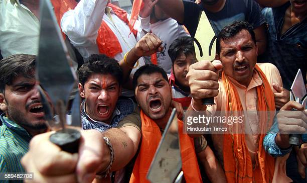 Activists of Bajrang Dal protesting against the crude bomb explosion near a Tata Sumo carrying Buddha Amarnath pilgrims near the main bus stand in...