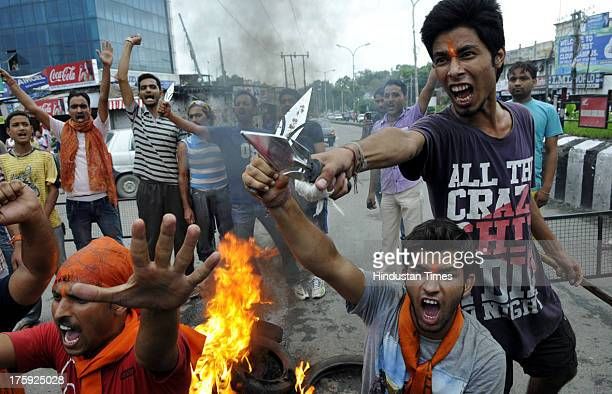 Activists of Bajrang Dal shouting slogans against MOS Home Sajjad Kichloo during a clash between protestors and Indian police officials on August 10...