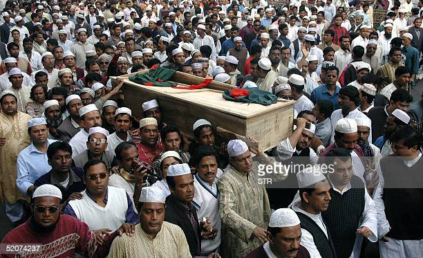 Activists of Bangladesh's main oppisition party Awami League carry the coffin of Awami League advisory council member and former finance minister...