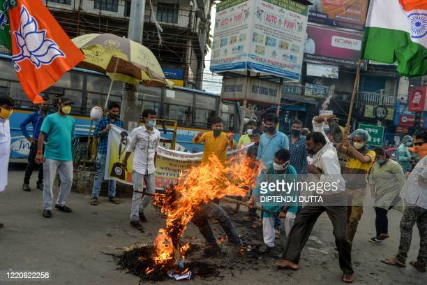 Activists of Bharatiya Janata Party shout slogans as they burn posters and an effigy of Chinese President Xi Jinping during an antiChina protest in...