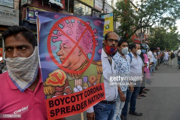 Activists of Bharatiya Janata Party stand in line as they hold posters during an antiChina protest in Siliguri on June 17 2020 India and China held...