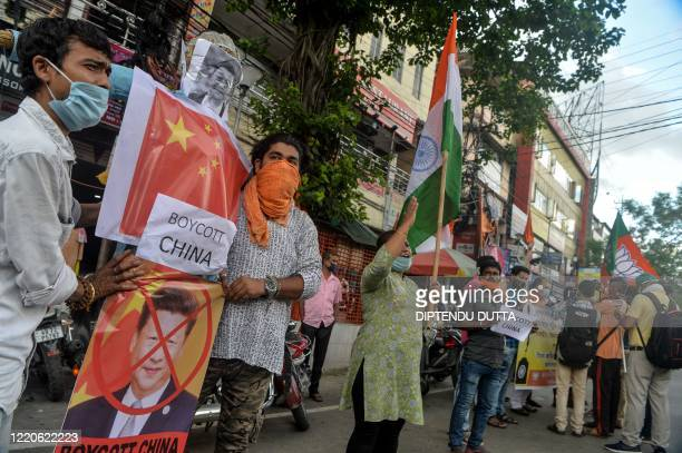 Activists of Bharatiya Janata Party stand in line as they prepare to burn an effigy of Chinese President Xi Jinping during an antiChina protest in...