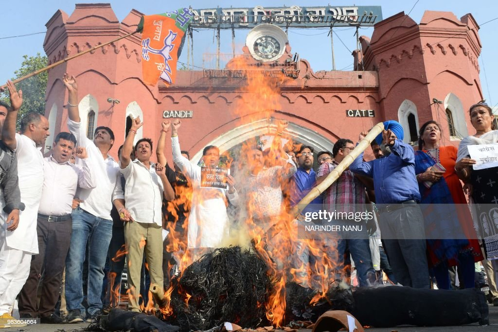 Activists of Bhartiya Janata Party shout slogans as they burn an effigy of Congress party during a demonstration as they observe the 1975 Emergency...