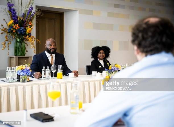 Activists of Black Lives Matter Netherlands and Kick Out Zwarte Piet Elvin Rigters and Lakeisha Tol meet Dutch Minister of Social Affairs and...
