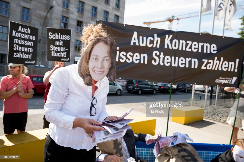 Activists protest in Berlin against tax evasion of corporations