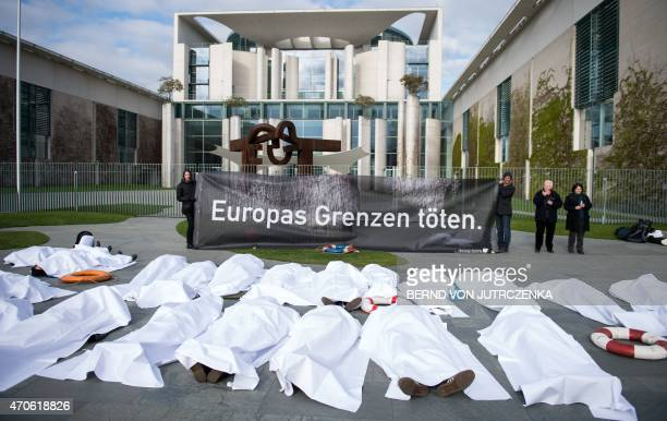 Activists of Campact Organization demand action for the rescue of refugees with a banner raeding 'Europe's borders kill' on April 22 2015 in front of...