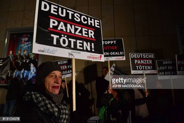 Activists of Campact Urgewald and Adopt a Revolution display placards calling on Germany to hold weapons exports to Turkey in front of the Bavarian...