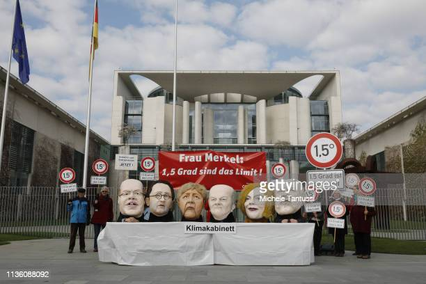 Activists of Campact wearing masks of Economy and Energy Minister Peter Altmaier Transport and Digital Infrastructure Minister Andreas Scheuer German...