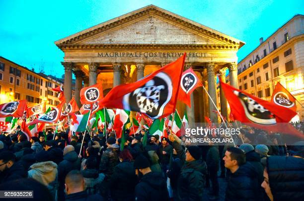 Activists of Casapound, a far right movement turned political party, wave flags during an election campaign meeting at the Pantheon square in Rome on...